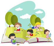 Kids reading books in the park Stock Photo