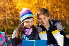 Kids reading homework Stock Image