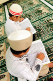 Kids Reading Koran stock photo