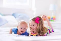 Kids reading in white bedroom Stock Photo