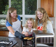 Kids ready to eat cookies fresh out of the oven Royalty Free Stock Photography