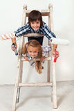 Kids ready to paint the wall Royalty Free Stock Images