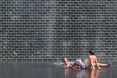 Kids refresh themselves by bathing with water Royalty Free Stock Image