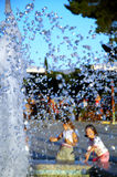 Kids refreshing. In fontana royalty free stock photo
