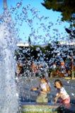 Kids refreshing. In fontana Royalty Free Stock Photo
