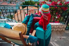 Kids relax on balcony terrace with suitcases, travel. And family vacation stock photos
