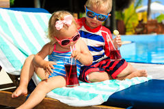 Kids relax on tropical beach resort and drink juices Royalty Free Stock Image