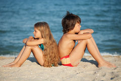 Kids relaxing on the beach Royalty Free Stock Photo