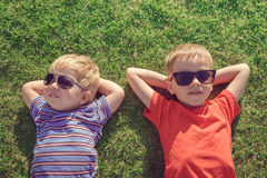 Kids relaxing on the grass Royalty Free Stock Images