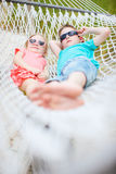 Kids relaxing in hammock Stock Photo