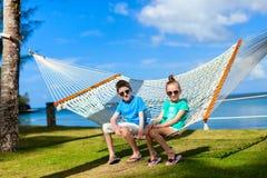 Kids relaxing in hammock Royalty Free Stock Photos