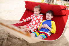 Kids relaxing in hammock Royalty Free Stock Photos