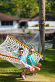 Kids relaxing in hammock Stock Photography