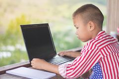 Kids are researching the Internet and old laptops. Educational concepts royalty free stock photography