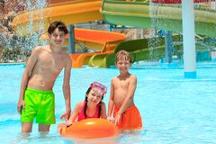 Kids in resort swimming pool Stock Photography