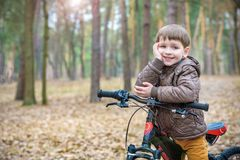 Kids resting after biking. Lay on his bike after long ride Stock Photography