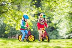 Free Kids Ride Balance Bike In Park Stock Images - 114163234