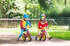 Free Kids Ride Balance Bike In Park Stock Photography - 92132992