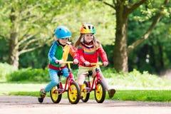 Free Kids Ride Balance Bike In Park Royalty Free Stock Photo - 96099745