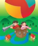 Kids ride on hot balloon Stock Image
