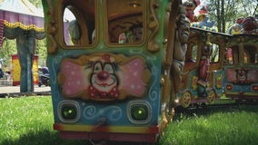Kids ride on the little electric train in park stock footage