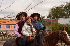 Kids riders on horses in hats royalty free stock photography