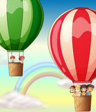 Kids riding on balloons in sky Royalty Free Stock Photography