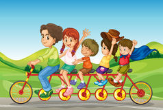 Kids riding a bicycle Stock Photography