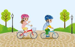 Kids riding bicycle in the park,wore Helmet Royalty Free Stock Photos