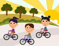 Kids riding a bike Stock Photos
