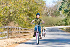 Kids riding bikes Royalty Free Stock Image