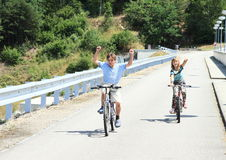 Kids riding bikes. Kids - little girl and boy riding bikes without holding royalty free stock photo