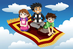 Kids riding on a flying carpet Stock Photos
