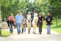 Kids riding horses in Prague ZOO. (Czech republic stock photography