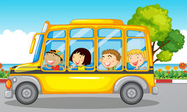 Kids riding on school bus Royalty Free Stock Photos