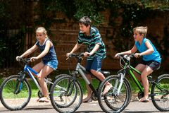 Kids riding theit bisycles. Royalty Free Stock Image