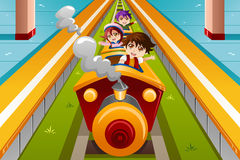 Kids riding a train Stock Photo