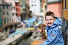 Kids in Riomaggiore village in Cinque Terre Royalty Free Stock Photo