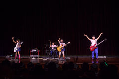 Kids rock band. The Rock Fairytale,a kids rock band performs in a fan club on the stage , September 5,2014,Liuzhou,China Royalty Free Stock Images