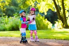 Free Kids Roller Skating In Summer Park Royalty Free Stock Image - 86051596