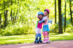 Free Kids Roller Skating In Summer Park Royalty Free Stock Images - 87028179