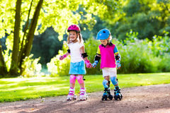 Free Kids Roller Skating In Summer Park Royalty Free Stock Photo - 87028725