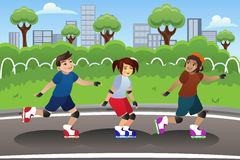 Kids Rollerblading Outdoor Stock Photo