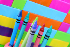 Kids Room. Kiddies Crayons proped upright in balls of clay against building blocks in the background Royalty Free Stock Photography