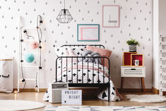 Kids room with colorful toys. Cute pillows on bed against white wallpaper with grey teardrops in cozy kids room with colorful toys Royalty Free Stock Photos