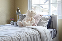 Kids room with dolls and pillows on bed Royalty Free Stock Photos