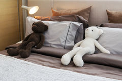 Kids room with dolls and pillows on bed Royalty Free Stock Photo