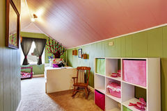 Kids room with green in pink color Royalty Free Stock Images