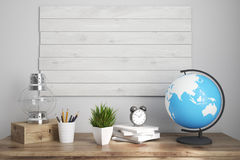 Kids room or home office brown table. Interior of a kids room with a wooden table, boards on a wall, an oil lamp, an alarm clock and a globe. Elements of this Royalty Free Stock Photography