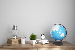 Kids room or a home office brown table. Interior of a kids room with a wooden table, an oil lamp, an alarm clock and a globe. Elements of this image furnished by Stock Photo